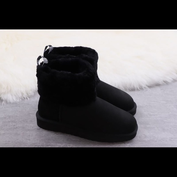 d4a1781d858 Black UGG Fluff Mini Quilted Logo Boots